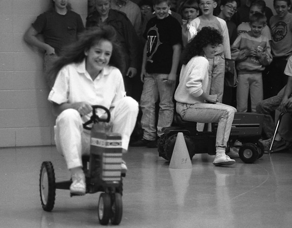 THE GOSHEN NEWS PHOTO  February 22, 1990<br /> This week has been FFA Week at Fairfield Junior-Senior High School, with the students doing their best to get in the farming spirit. One such event was the annual mini-tractor races, which occurred this morning. Shown here squeeling through the race course are students Toni Bankson, left and Angela Mast. Other events taking place this week included the bale-throwing contest Wednesday. FFA members will cook breakfast for Fairfield teachers and staff members Friday to round out the week.