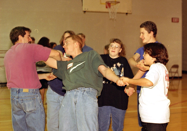 THE GOSHEN NEWS PHOTO  Back When Nov. 18, 1996<br /> All Knotted Up: Westview students, parents and staff find themselves in a human knot while participating in Kids Day Saturday at the junior-senior high school. Clockwise from left are Jeff Whitmer, Amanda Markha (particially hidden), Julie Marner, Ryan Neiswinger, Melissa Slone and Barry Taylor. The human knot activity promotes problem solving, communication and teamwork; the goals of Kids Day were to improve relationships between students and adults and promote a healthy climate in the school.