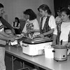 THE GOSHEN NEWS PHOTO  Back When March 22, 1994<br /> Jaye Sleppy, left, fills his plate with assistance from volunteers Deb Schmell, Angel Myers, Jessica Compton and Nean Smith, as a fundraising haystack dinner for the Middlebury Day Care Ministry, held Saturday at Middlebury First Mennonite Church. Six Middlebury churches are working together on the ministry, and plan to open the doors of their new day car facility this fall. The MDCM board is seeking a director for the day care. The day care will be located in St. Paul's Luthern Church, Middlebury. For more information about the day care center, contact Nelda Snider, board secretary, at 825-5125.