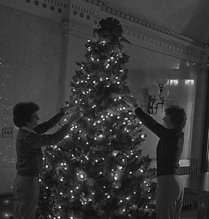 THE GOSHEN NEWS PHOTO  BACK WHEN Dec. 22, 1982<br /> Jackie Lamb, left, and Jean Berger, Elkhart County Commissioners' secretaries, decorated the Christmas tree standing in the courthouse lobby. The high ceiling in the courthouse provided plenty of room for the 10-foot tree. The courthouse employees held a Christmas party last Thursday, and are scheduled for a day of vacation Friday. Many offices and businesses will also be closed the day before Christmas.