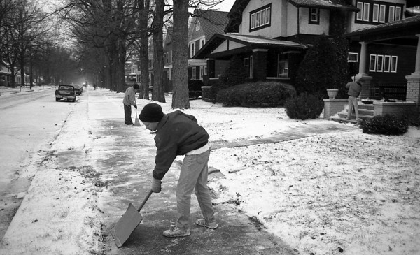 THE GOSHEN NEWS PHOTO  BACK WHEN Nov. 24, 1991<br /> Snow over the weekend started off Thanksgiving week in the Goshen area. There was 1.5 inches recorded at the Goshen College weather station, according to Lores Steury, weather observer. The Wallach brothers were out shoveling off the walk in front of their South Sixth Street home Sunday afternoon.Ted, 13, uses a snow shovel in the froeground, while William, 11, uses a broom and Andrew, 18, sweeps off the porch steps. A peek at the Thanksgiving Day forecast calls for dry weather with the highs in the lower 40s.
