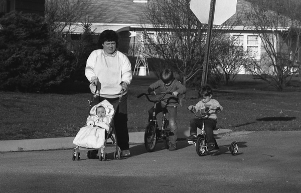 THE GOSHEN NEWS PHOTO  Back When April 5, 1988<br /> Temperatures were in the mid-60s on Monday and were expected to be above 70 derees today, encouraging Goshen-area residents to enjoy the outdoors. Wanda Miller took advantage of the pleasant weather Monday evening to take her three children on a little outing near their South 12th Street home. She is pictured with Natalie, 9 months, Nicholas, 5, on the bicycle, and Nathan, 2, following on his trike. Many school students on spring vacation were also enjoying the weather warmup.