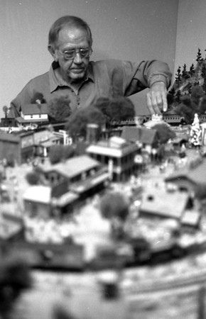 THE GOSHEN NEWS PHOTO  BACK WHEN Dec. 15, 1987<br /> Given the opportunity to build his own town, Bob Herring, Goshen, chose to make his a Western one. Of course his is only a miniture one which surrounds his HO scale train set. Herring started this project three years ago and has expanded upon it ever since.