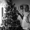 THE GOSHEN NEWS PHOTO  THE GOSHEN NEWS | DEC. 21, 1986<br /> CARL CHUPP has found something interesting to do with fishing lures between trips to the lake: put them on the Christmas tree. Chupp, 16277 C.R. 40, has covered his tree with some of his salmon lures to provide colorful, if unusual, ornamentation.