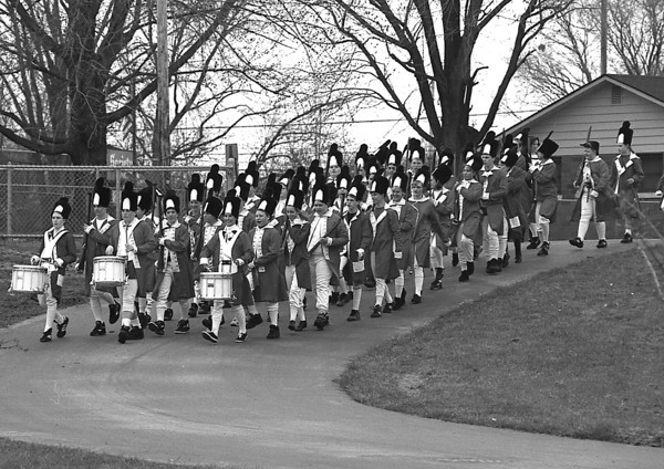 THE GOSHEN NEWS PHOTO  April 20, 1993<br /> The Concord Junior High School Lexington battle re-enactment is about to begin: British soldiers, marching in formation advance on the Lexington green in hopes of destroying the colonists' military supplies. Paul Revere, riding through the night of April 18, 1775, warned the colonists of the approaching troops and minutemen faced off against the troops on the morning of April 19.