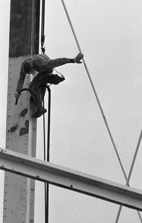 "THE GOSHEN NEWS PHOTO  BACK WHEN Oct. 27, 1983<br /> Progress on repainting the Jackson Street water tower has been slowed by the rainy weather of the past several days, but work crews were back on the job Wednesday as the sun finall broke through the overcast. Workers are sandblasting and priming the tower. They must prime the raw metal which is uncovered each day to prevent rusting overnight. The tower will receive one primer coat, which is being applied with rollers, and two color coats which will be sprayed. The paint is formulated so that the overspray turns to powder if it is carried away by wind and will not harm cars and buildings in its path. The tower will be an ""eggshell"" color when the project is completed."