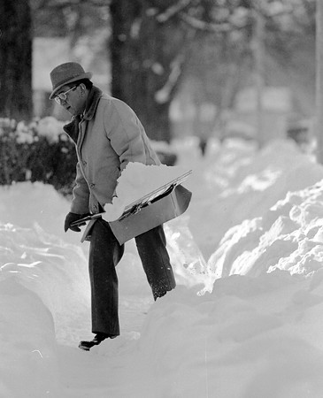 THE GOSHEN NEWS PHOTO  THE GOSHEN NEWS | JAN. 25, 1987<br /> Charles Gautsche, Archbold, Ohio, is in town for Mennonite Church board meetings and spent some time Friday moving snow at the home of his son, Larry, at 701 S. Seventh St., when this photograph was taken. Charles Gautsche is chairman of the Mennonite Board of Education.
