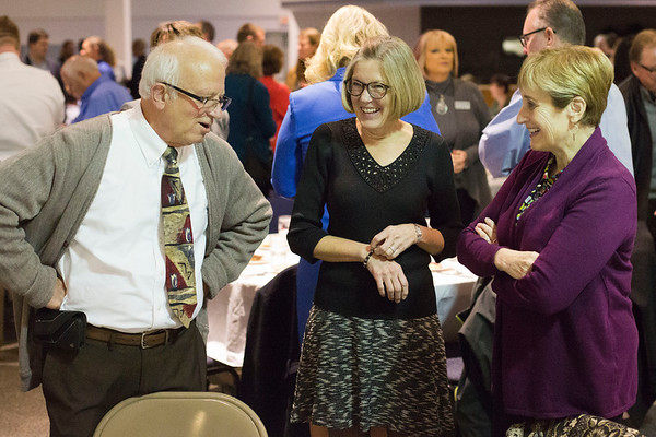 JAY YOUNG | THE GOSHEN NEWS<br /> From left, Gregg Nussbaum, Laurie Nafziger and Chris Schoeninger, all of Oaklawn, share a laugh as they mingle before the start of the Goshen Chamber's 2016 Annual Meeting on Thursday at Maple City Chapel, 2015 Lincolnway East.