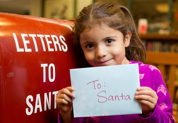 JAY YOUNG | THE GOSHEN NEWS<br /> Five-year-old Bella Macias, of Goshen, holds her letter to Santa before dropping it in Santa's mailbox at the Goshen Public Library, 601 S 5th St. Bella's parents are Salvador and Rosa Macias. Bella attends St. John the Evangelist Catholic School, 117 W Monroe St.