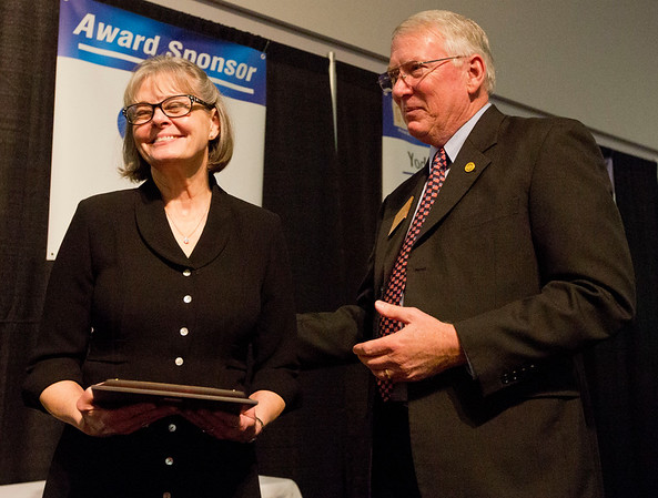 JAY YOUNG | THE GOSHEN NEWS<br /> Rhonda Daugherty grins before presenting an award to her husband, Chamber of Commerce President David Daugherty during the Goshen Chamber's 2016 Annual Meeting on Thursday at Maple City Chapel, 2015 Lincolnway East. The two own Kercher's Sunrise Orchards.