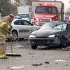 JAY YOUNG | THE GOSHEN NEWS<br /> A New Paris firefighter sweeps up debris after an accident at the intersection of roads 15 and 142 in New Paris on Tuesday morning.