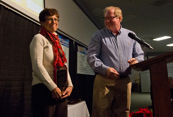JAY YOUNG | THE GOSHEN NEWS<br /> Tom Kercher turns to his wife, Maureen, and smiles while the two accept the 2016 Maple Leaf Award for Large Business of the Year during the Goshen Chamber's 2016 Annual Meeting on Thursday at Maple City Chapel, 2015 Lincolnway East. The two own Kercher's Sunrise Orchards.