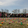 JOHN KLINE | THE GOSHEN NEWS<br /> Colorful, prize-filled Easter eggs blanket the lawn of Grace Community Church as eager 4th, 5th and 6th graders await the call to begin the hunt during one of several Easter egg hunts held at the church Sunday afternoon.