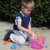 JOHN KLINE | THE GOSHEN NEWS<br /> Lucas Ryman, 3, of Cleveland, Ohio, surveys his stash of Easter candy and prizes following an Easter egg hunt at the Goshen City Church of the Brethren Sunday morning.