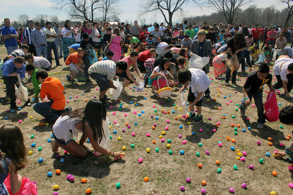 JOHN KLINE | THE GOSHEN NEWS<br /> Middle schoolers swarm an Easter egg-strewn field at Grace Community Church Sunday during one of several Easter egg hunts held as part of the church's annual Community Easter Celebration.