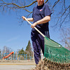 SAM HOUSEHOLDER | THE GOSHEN NEWS<br /> Gary Clark of Goshen rakes up the yard of his sister and brother-in-law's home on Eighth Street Wednesday afternoon. Clark said the nice weather made him want to get out and do yard and help his family in the process.
