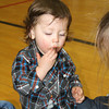 SHERRY VAN ARSDALL | THE GOSHEN NEWS<br /> One-year-old Ollie Plikard eats a piece of candy from one of his eggs Saturday. There were more than 300 children hunting for 8,000 eggs  in the Millersburg Lions Club Easter Egg Hunt at Millersburg Elementary School.