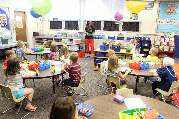 JULIE CROTHERS   THE GOSHEN NEWS<br /> Students in Carrie Johnson's Nappanee Elementary School kindergarten class get to work right away Thursday on the first day of school.