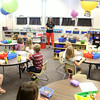 JULIE CROTHERS | THE GOSHEN NEWS<br /> Students in Carrie Johnson's Nappanee Elementary School kindergarten class get to work right away Thursday on the first day of school.