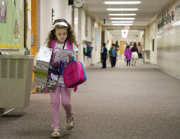 SAM HOUSEHOLDER | THE GOSHEN NEWS<br /> First grader Rylie Porter checks a map to find her classroom Wednesday at Ox Bow Elementary School. The Concord Community Schools year began Wednesday.