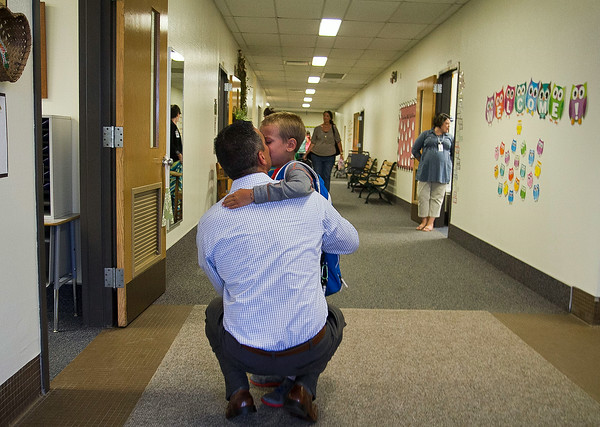 SAM HOUSEHOLDER | THE GOSHEN NEWS<br /> Bill Clark kisses his son, Mason, good bye before sending him into his second grade class Tuesday at Shipshewana Scott Elementary School. Tuesday was the first day of school for the Westview School Corporation.