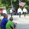 JULIE CROTHERS | THE GOSHEN NEWS<br /> Friends Kile Judy, at left, and Carl Young, both 12, watch as the Millersburg Farmer's Day parade begins Saturday.