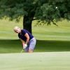 SAM HOUSEHOLDER | THE GOSHEN NEWS<br /> Norine Troeger, of Berkshire Hathaway, chips onto the green during the Goshen Chamber of Commerce Golf Outing Wednesday at Maplecrest Country Club in Goshen.
