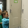 JULIE CROTHERS | THE GOSHEN NEWS<br /> Clinton Christian School fifth grader Tyler Yoder stuffs his backback and books into his locker before heading to class on the first day of school.