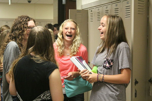 JULIE CROTHERS   THE GOSHEN NEWS<br /> Wawasee High School freshmen Morgan Jones, left, and Morgan Perry, right, share a laugh with friends before class begins Tuesday on the first day of school.