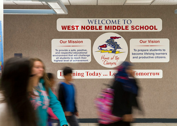 SAM HOUSEHOLDER   THE GOSHEN NEWS<br /> Students walk past the sign welcoming them to West Noble Middle School Friday on the first day of school.