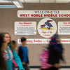 SAM HOUSEHOLDER | THE GOSHEN NEWS<br /> Students walk past the sign welcoming them to West Noble Middle School Friday on the first day of school.