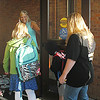 AMY WENGER | THE GOSHEN NEWS<br /> Teacher Laurie Frantz wears a smile as bright as the sunlight as she welcomed children to the start of the 2014-15 school year at Wakarusa Elementary on Thursday morning.