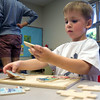 SAM HOUSEHOLDER | THE GOSHEN NEWS<br /> Jacob Weaver works on a puzzle Friday at Walnut Hill Early Elementary Center in Goshen.