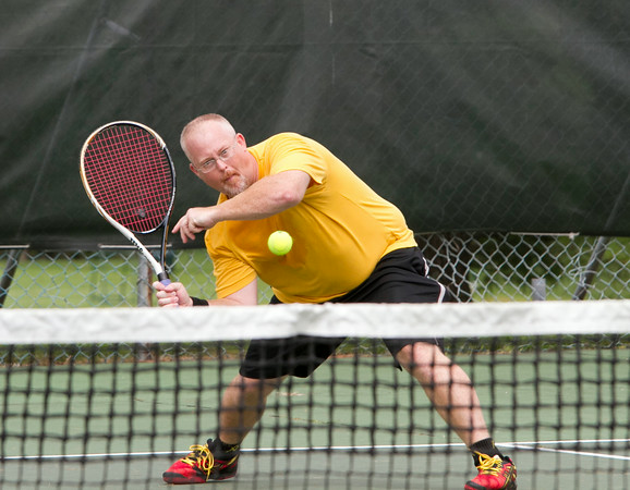 SAM HOUSEHOLDER | THE GOSHEN NEWS<br /> Tim Thomas, of Fox Brothers, hits a ball during the Goshen Chamber of Commerce Golf and Tennis Outing Wednesday at Maplecrest Country Club in Goshen.