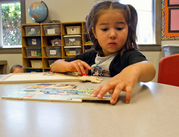 SAM HOUSEHOLDER | THE GOSHEN NEWS<br /> Audrey Bradley, 4, works on a puzzle Friday at the Walnut Hill Early Childhood Center.
