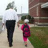 SAM HOUSEHOLDER | THE GOSHEN NEWS<br /> Shipshewana Scott Elementary School principal Ian Zuercher walks a student into the school Tuesday. The Westview school district returned for the 2014-2015 school year.