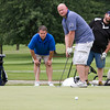SAM HOUSEHOLDER | THE GOSHEN NEWS<br /> From left, Jason Bollinger, Don Nyce, Jeremy Carner and Rick Kurtz watch Carner's putt Wednesday during the Goshen Chamber of Commerce Golf Outing at Maplecrest Country Club.