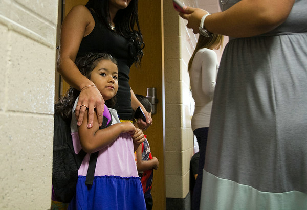 SAM HOUSEHOLDER   THE GOSHEN NEWS<br /> Tania Medina stands with relatives before her first day of Kindergarten Wednesday at Jefferson Elementary School. Middlebury Community Schools returned for the 2014-2015 school year Wednesday.