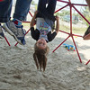 SAM HOUSEHOLDER | THE GOSHEN EWS<br /> Audrey Bradley, 4, hangs from the playground at Walnut Hill Early Childhood Center Friday.
