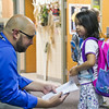 SAM HOUSEHOLDER | THE GOSHEN NEWS<br /> Ox Bow Elementary School principal Kent Myers helps Ana Hernandez find her kindergarten classroom Wednesday on the first day of school.