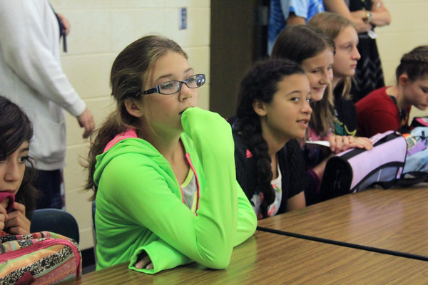 JULIE CROTHERS   THE GOSHEN NEWS<br /> Laci Johnson, 11, and her Northridge Middle School sixth-grade classmates listen Wednesday morning during an orientation program on the first day of school.