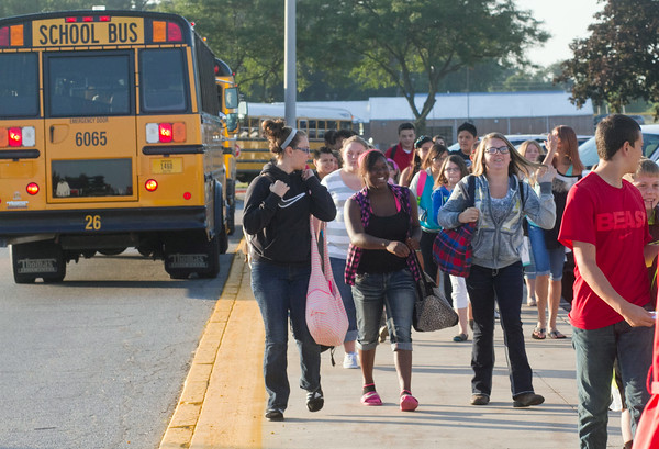SAM HOUSEHOLDER   THE GOSHEN NEW<br /> West Noble Middle School students head into the school Friday for the first day of the 2014-2015 school year.
