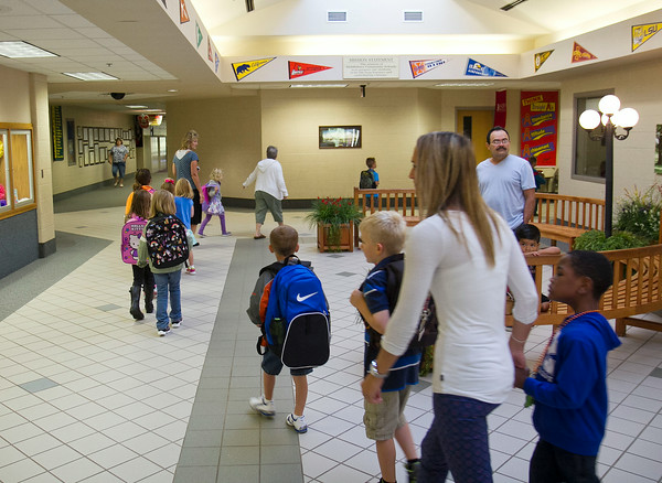 SAM HOUSEHOLDER | THE GOSHEN NEWS<br /> Kindergarteners, teachers and parents file into Jefferson Elementary School Wednesday for the first day of school. Jefferson is part of the Middlebury Community School system.