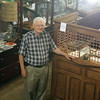 JULIE CROTHERS | THE GOSHEN NEWS<br /> John Hertzler, a lifelong Goshen resident, stands among the artifacts, photographs and documents at the Goshen Historical Society museum, 124 S. Main St.