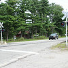 JOHN KLINE | THE GOSHEN NEWS<br /> A vehicle passes through the Division Street railroad crossing in New Paris Friday morning. Significant safety improvements are slated for the crossing beginning in 2016.