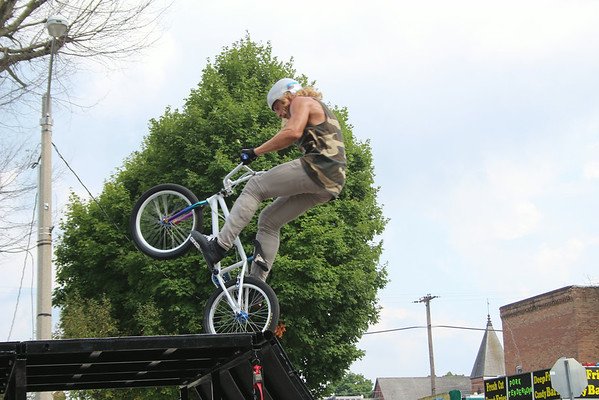 JOHN KLINE | THE GOSHEN NEWS<br /> Tyler Sparr of Pensacola, Fla., balances his bike on its back tire during a professional BMX Jump Show in Ligonier Sunday. The show was one of many fun events offered during the 23rd annual Ligonier Marshmallow Festival.