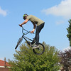 JOHN KLINE | THE GOSHEN NEWS<br /> Ben Eylander of Chicago wows the crowd with a high-flying jump during a BMX Jump Show at the Ligonier Marshmallow Festival Sunday.