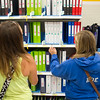 SAM HOUSEHOLDER | THE GOSHEN NEWS<br /> Grace Hostetler, left, of Wakarusa and Kelsey Roe, of Goshen, pick out binders at Target Tuesday in Goshen. With the school year beginning soon parents and students are out back to school shopping for all the essentials.