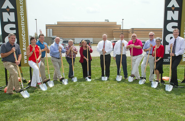 SAM HOUSEHOLDER | THE GOSHEN NEWS<br /> Goshen Community Schools broke ground Monday on their projects at Goshen High School and Goshen Middle School. The middle school will be getting a new pool while the high school gets a new band and chior area. Pictured at the ceremony held at the middle school are, from left, Tom Boomershine. GCS facilities manager, Lori Shreiner, GMS principal, Nick Kieffer, Goshen Chamber of Commerce vice president, Jerry Hawkins, director of finance for GCS, Dan west, school board secretary, Jane Troup, school board president, Jim Ramer, school board member, Sean Welty, Ancon Construction project manager, Barry Younghans, GHS principal, Kari Vilamaa, architect Barton-Coe-Vilamaa, Diane Woodworth, GCS superintendent and John Place, president of Ancon Construction.