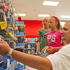 SAM HOUSEHOLDER | THE GOSHEN NEWS<br /> Richard Darling, right, picks out some supplies Tuesday at Target in Goshen with daughter Keirstan, 11, a sixth grader, middle and friend Destinee Bornkamp, 13, a seventh grader. The girls will be students at NorthWood Middle School this fall.
